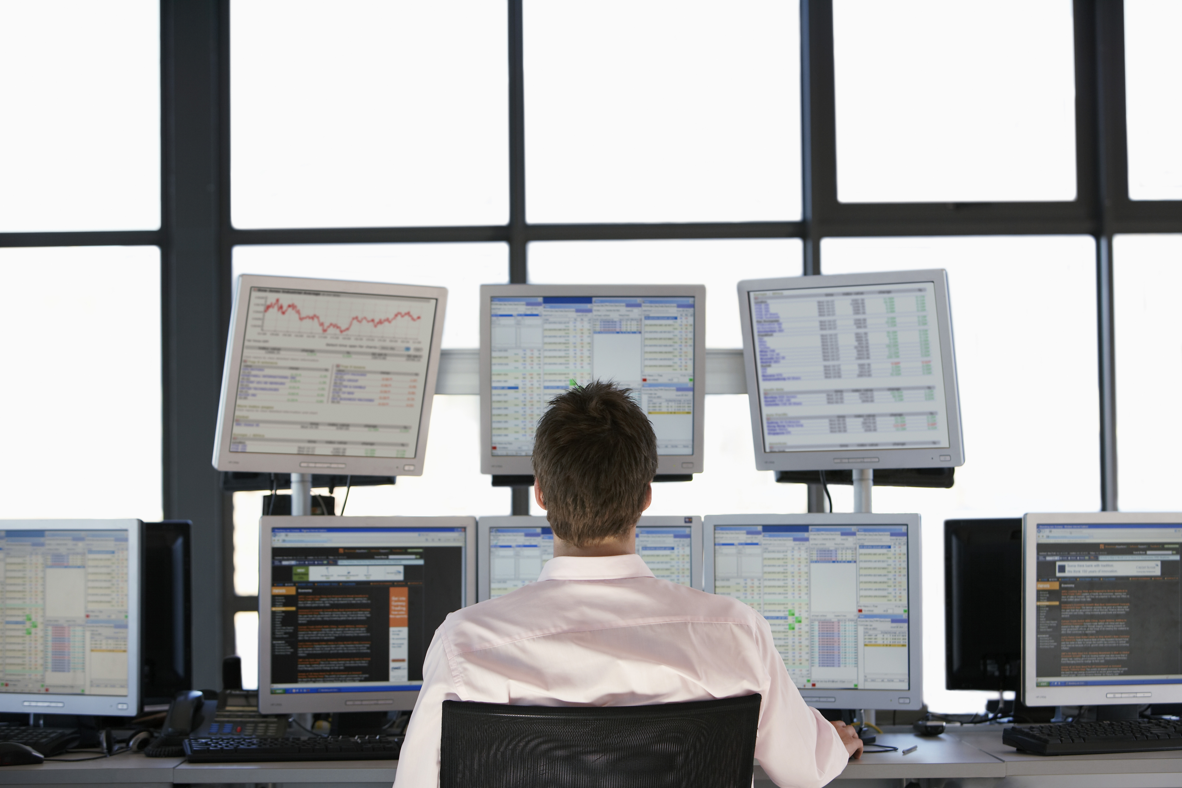 Businessmen Watching Data on Flat Panel Monitors